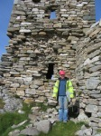 Project Archaeologist, Richard Crumlish examining south wall of keep before making site drawings.
